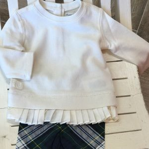 Ivory Polo top with plaid leggings